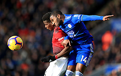 Manchester United's Paul Pogba (left) and Leicester City's Ricardo Pereira battle for a header during the Premier League match at the King Power Stadium, Leicester.