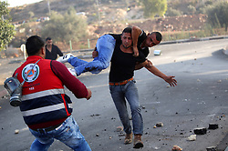 08.10.2015, Ramallah, PSE, Gewalt zwischen Palästinensern und Israelis, im Bild Zusammenstösse zwischen Palästinensischen Demonstranten und Israelischen Sicherheitskräfte // A Palestinian protester carries his wounded fellow during clashes with Israeli security forces in Beit El, near the West Bank city of Ramallah. New violence rocked Israel and the Israeli occupied West Bank, including an incident in which men thought to be undercover Israeli police opened fire on Palestinian stone throwers they had infiltrated, wounding three of them, Palestine on 2015/10/08. EXPA Pictures © 2015, PhotoCredit: EXPA/ APAimages/ Shadi Hatem<br /> <br /> *****ATTENTION - for AUT, GER, SUI, ITA, POL, CRO, SRB only*****