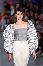 © Licensed to London News Pictures. 13/09/2019. LONDON, UK.  A model presents a look by Wear Polish: Diligent during Fashion Scout SS20, an off schedule show at Victoria House in Bloomsbury Square, on the opening day of London Fashion Week.  Photo credit: Stephen Chung/LNP