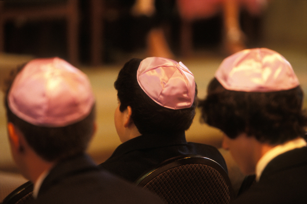 Jewish boys wearing kippah, or scullcap, during a girl's bat mitzvah, her coming-of-age ritual, at Temple Avoda, a Reform synagogue, in Fair Lawn, New Jersey, USA.