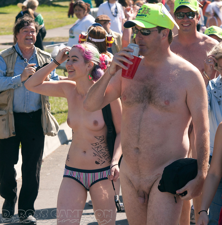 Unidentified naked people -- part of the Bare to Breakers group of naturists who walk the course in the nude each year -- traipse through Golden Gate Park at the 97th running of the Bay to Breakers 12K race, Sunday, May 18, 2008 in San Francisco. (Photo by D. Ross Cameron)