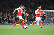 Arsenal attacker Theo Walcott (14) dribbling and being chased by Bayern Munich midfielder Arturo Vidal (23) during the Champions League round of 16, game 2 match between Arsenal and Bayern Munich at the Emirates Stadium, London, England on 7 March 2017. Photo by Matthew Redman.