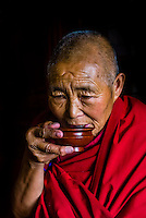 A Buddhist nun drinking yak butter tea, Drepung Monastery, Tibet (Xizang), China