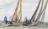 Toe in the Water Too (right), sailed by injured military personnel, racing in IRC class 0 on the opening day of Aberdeen Asset Management Cowes Week. The event began in in 1826 and plays a key part in the British sporting summer 'season'. It now stages up to 40 daily races for around 1,000 boats and is the largest sailing regatta of its kind in the world with 8,500 sailors competing.<br /> Picture date Saturday 2nd August, 2014.<br /> Picture by Christopher Ison. Contact +447544 044177 chris@christopherison.com