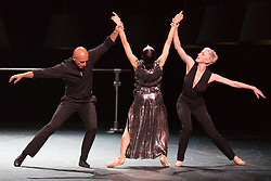"""© Licensed to London News Pictures. 14/04/2015 London, England. L-R: Gaetan Morlotti, Diana Vishneva and Bernice Coppieters. Diana Vishneva, star of the Mariinsky Ballet and the American Ballet Theatre, performs the piece """"Switch"""" at a photocall for the UK premiere of Diana Vishneva: On the Edge at the London Coliseum. The show runs from for three performances on 14, 16 and 18 April 2015. Dancers: Diana Vishneva, Bernice Coppieters and Gaetan Morlotti. Choreography by Jean-Christophe Maillot. Diana Vishneva's costume was created by Karl Lagerfeld. Photo credit: Bettina Strenske/LNP"""