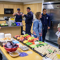 041515       Cable Hoover<br /> <br /> FIrefighters and visitors mingle in the renovated kitchen during an open house at Fire Station No. 1 in Gallup Wednesday.