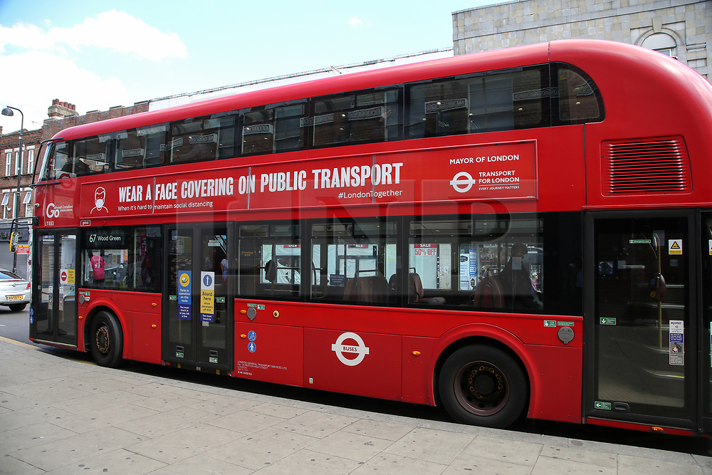 © Licensed to London News Pictures. 13/06/2020. London, UK. 'WEAR A FACE COVERING ON PUBLIC TRANSPORT', the government's new public information campaign displayed on a London double decker bus. Face covering will be compulsory on buses, trains, trams and planes from Monday 15 June. Secretary of State for Transport, Grant Shapps has said that, people who do not wear face covering on public transport from Monday could be fined up to £100. Photo credit: Dinendra Haria/LNP