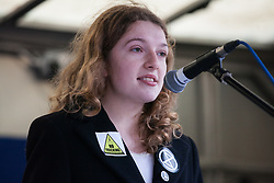 London, UK. 1st December, 2018. Anna Gretton of Extinction Rebellion addresses the Together for Climate Justice demonstration against Government policies in relation to climate change, including Heathrow expansion and fracking. Following a rally outside the Polish embassy, chosen to highlight the UN's Katowice Climate Change Conference which begins tomorrow, protesters marched to Downing Street.
