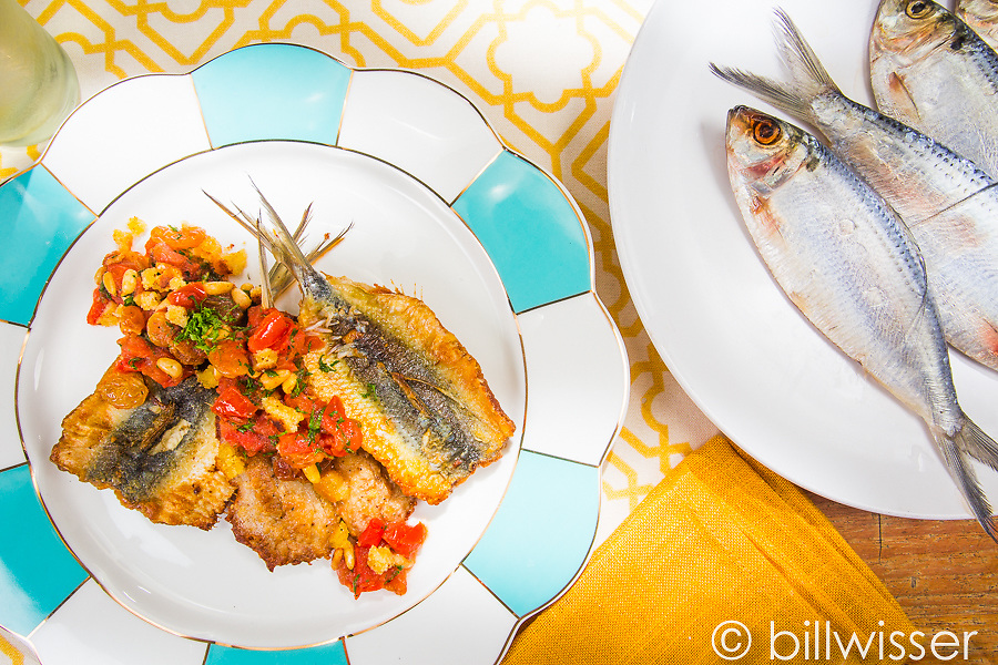 Sardines with pine nuts, sultanas and fresh tomatoes