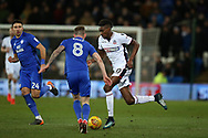 Sammy Ameobi of Bolton Wanderers ® runs past Joe Ralls of Cardiff city (8) . EFL Skybet championship match, Cardiff city v Bolton Wanderers at the Cardiff city Stadium in Cardiff, South Wales on Tuesday 13th February 2018.<br /> pic by Andrew Orchard, Andrew Orchard sports photography.
