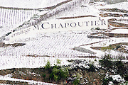 ermite vineyard M Chapoutier. The Hermitage vineyards on the hill behind the city Tain-l'Hermitage, on the steep sloping hill, stone terraced. Sometimes spelled Ermitage. Vineyards under snow in seasonably exceptional weather in April 2005. Tain l'Hermitage, Drome, Drôme, France, Europe