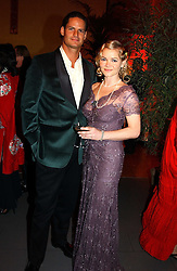 CHRISTINA KNUDSEN and NICHOLAS BOURNE at Andy & Patti Wong's Chinese New Year party to celebrate the year of the Rooster held at the Great Eastern Hotel, Liverpool Street, London on 29th January 2005.  Guests were invited to dress in 1920's Shanghai fashion.<br /><br />NON EXCLUSIVE - WORLD RIGHTS