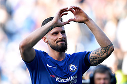 Chelsea's Olivier Giroud celebrates after the final whistle during the Premier League match at Stamford Bridge, London.