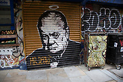 Street art Winston Churchill on shutters in the Brick Lane area of Shoreditch, East London, United Kingdom. Street art in the East End of London is an ever changing visual enigma, as the artworks constantly change, as councils clean some walls or new works go up in place of others. While some consider this vandalism or graffiti, these artworks are very popular among local people and visitors alike, as a sense of poignancy remains in the work, many of which have subtle messages.