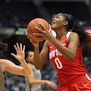 HARTFORD, CONNECTICUT- DECEMBER 19: Tori McCoy #0 of the Ohio State Buckeyes drives to the basket defended by Natalie Butler #51 of the Connecticut Huskies  during the UConn Huskies Vs Ohio State Buckeyes, NCAA Women's Basketball game on December 19th, 2016 at the XL Center, Hartford, Connecticut (Photo by Tim Clayton/Corbis via Getty Images)