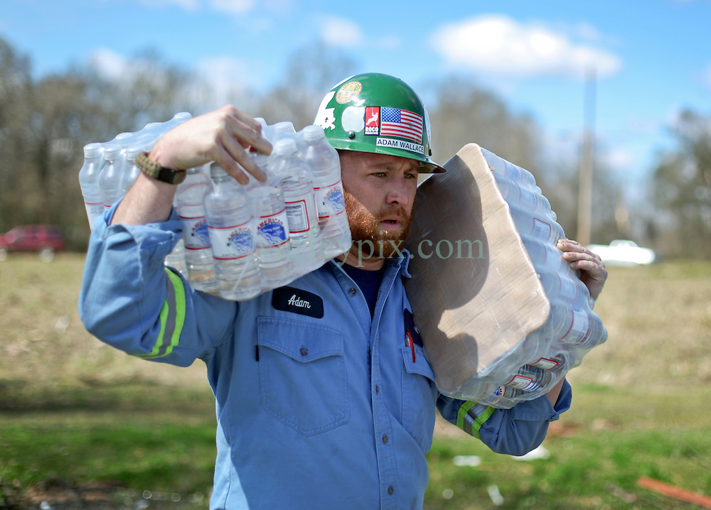 24 February 2016. Schexnaydre St, Convent, Louisiana.<br /> Scenes of devastation following a deadly EF2 tornado touchdown. 2 confirmed dead. <br /> Adam Wallace  of steel giant NUCOR Corporation delivers vital supplies donated to neighborhoods hardest hit by the storm.<br /> Photo©; Charlie Varley/varleypix.com