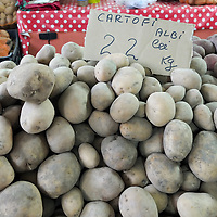 TIMISOARA, ROMANIA - APRIL 21:  A sign shows the price of Potatoes in Romanian Leu at a vegetable Market on April 21, 2013 in Timisoara, Romania.  Romania has abandoned a target deadline of 2015 to switch to the single European currency and will now submit to the European Commission a programme on progress towards the adoption of the Euro, which for the first time will not have a target date. (Photo by Marco Secchi/Getty Images)
