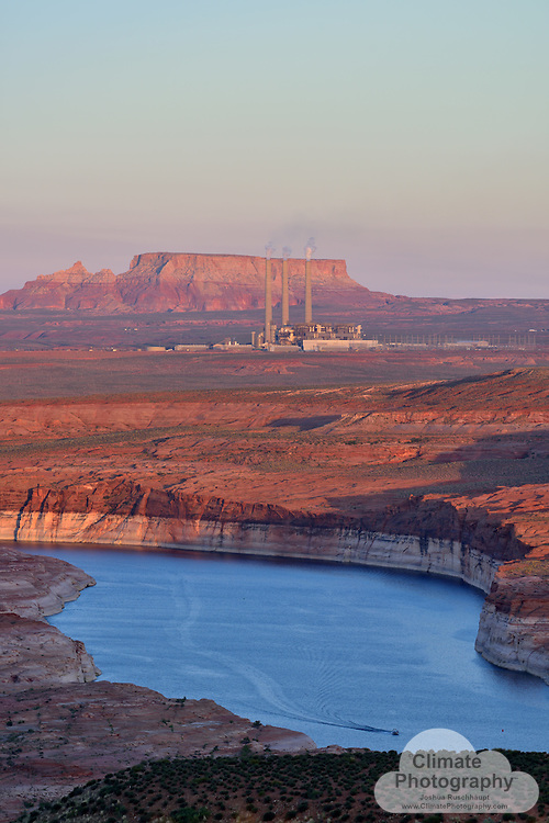 #ThisIsClimateChange Arizona has floating cities... in the desert (figuratively).  Snaking through topographical lines of desert geography are the sinuous man-made rivers flowing uphill (literally), from a river that ceases to end at the ocean and into cities that are built on the foundation and guarantee of a costly water supply.<br /> <br /> And all that water infrastructure is powered by coal.  The Navajo Generating Station, in Page, AZ, to be exact.  This over 2,000 Megawatt station pushes water uphill via pumps throughout the Central Arizona Project canal.  ProPublica has an extensive story covering this history and current impacts and diminished Colorado River expectations here: https://projects.propublica.org/killing-the-colorado/story/navajo-generating-station-colorado-river-drought.<br /> <br /> All that coal being burned has a visible impact on our atmosphere, noticeable in this gallery's images.  The smog created really soaks in the brilliant desert sunsets and sunrises like the red rock sandstone country where it is located.  Invisible, however, are the tens of thousands of tons of carbon dioxide emitted every day.  Arizona's water supply, via the CAP, has a massive carbon dump into the atmosphere, with no price or consequence for dumping it there.<br /> <br /> Unfortunately, that pollution is contributing to an impact on how much water is available for delivery by the CAP itself, due to climate-enhanced drought and over-allocation.  So, there may be a consequence after all.