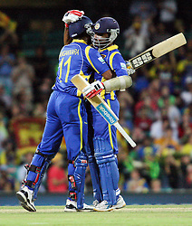 © Licensed to London News Pictures. 17/02/2012. Sydney Cricket Ground, Australia. Mahela Jayawardene (right) congratulates & hugs Kumar Sangakkara (left) after he achieved 10,000 career one day international runs  during the One Day International cricket match between Australia Vs Sri Lanka. Photo credit : Asanka Brendon Ratnayake/LNP