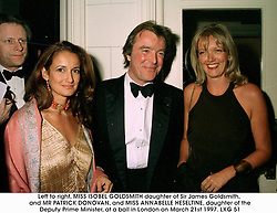 Left to right, MISS ISOBEL GOLDSMITH daughter of Sir James Goldsmith, and MR PATRICK DONOVAN, and MISS ANNABELLE HESELTINE, daughter of the Deputy Prime Minister, at a ball in London on March 21st 1997.LXG 51