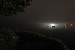 Night View West toward Portland in Casco Bay, South Harpswell, Maine. Credit Photography: James R Anderson