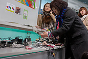 People charge their cellphones in a shop in Shibuya after a magnitude .9 earthquake hit the Tohoku region of north east Japan causing tremors in Tokyo that stopped the train and cellphone networks. Many people were stranded in the centre of Tokyo over night. Tokyo, Japan Friday March 11th 2011