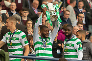Olivier Ntcham holds the William Hill Scottish Cup aloft following their victory today in the William Hill Scottish Cup Final match between Heart of Midlothian and Celtic at Hampden Park, Glasgow, United Kingdom on 25 May 2019.
