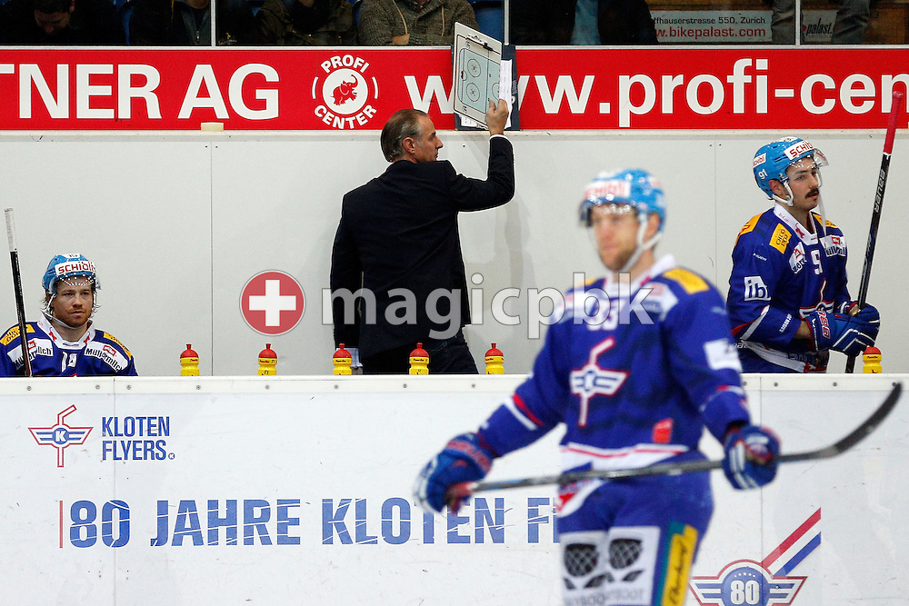 Kloten Flyers Cheftrainer Felix (Fige) Hollenstein on his way out after a National League A ice hockey game between between Kloten Flyers and HC Fribourg-Gotteron held at the Kolping Arena in Kloten, Switzerland, Saturday, Nov. 15, 2014. (Photo by Patrick B. Kraemer / MAGICPBK)