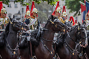 The Queens escort, the Household Cavalry - Colonel's Review 2018, the last formal inspection of the Household Division before The Queen's Birthday Parade, more popularly known as Trooping the Colour. The Coldstream Guards Troop Their Colour and their Regimental Colonel, Lieutenant General Sir James Jeffrey Corfield Bucknall, takes the salute.