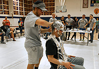 "Scott Hutchison gets a special flour and maple syrup pie from Tyler Pearson at Gilford High School Friday afternoon during the ""Pie a Teacher"" fundraiser to benefit The Doorway at LRGH.  (Karen Bobotas/for the Laconia Daily Sun)"