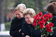 Moscow, Russia, 26/04/2007..Boris Yeltsin's widow Naina and daughters Yelena [black scarf] and Tatyana [dark glasses] make a private visit to to his grave the morning after the former Russian President was buried. Yelena supports her mother as Tatyana lays roses on the grave..