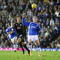 Photo: Dave Linney.<br />Birmingham City v Plymouth Argyle. Coca Cola Championship. 02/12/2006. Bham City's Nicklas Bendtner(R) keeps an eye on the ball despite the attention of  Gary Swayer.