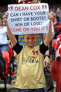 a Young Layton Orient fan holding up a sign of Leyton Orient's Dean Cox for boots and shirt . Skybet football league one play off final match , Leyton Orient  v Rotherham Utd at Wembley Stadium in  London on Sunday 25th May 2014.<br /> pic by John Patrick Fletcher, Andrew Orchard sports photography.