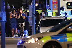 © Licensed to London News Pictures. 03/06/2017. London, UK. Armed police demands a member of public to leave the area near Southwark Bridge after reports of an incident involving a vehicle and pedestrians in London Bridge.  Reports are saying a white transit van may have deliberately run down people crossing the bridge. Photo credit: Tolga Akmen/LNP