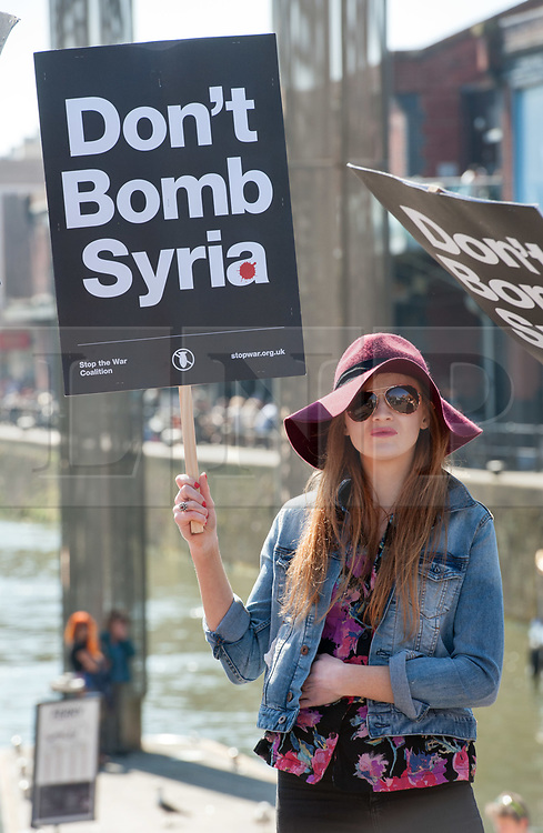 © Licensed to London News Pictures. 08/04/2017. Bristol, UK. 'Don't Bomb Syria' protest in Bristol city centre against the recent US cruise missile strike on the Syrian airbase which is alleged to have been used by Syrian military to use chemical weapons to bomb rebels in the Syrian civil war. The protest was organised by Bristol Stop the War group. Photo credit : Simon Chapman/LNP