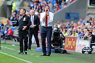 Cardiff city's manager Malky Mackay shouts out his instructions. Barclays Premier League match, Cardiff city v Newcastle Utd  at the Cardiff city stadium in Cardiff, South Wales on Saturday 5th Oct 2013. pic by Andrew Orchard, Andrew Orchard sports photography,