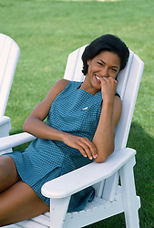 African American Woman in a chair on a grassy lawn