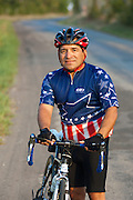 Cyclist Carlos Valdez, of Weatherford, Texas, pauses during a morning ride west of Weatherford on Wednesday August 31, 2011. Valdez rode his bicyclye across Texas in one week this summer.<br /> Robert W. Hart/Special Contributor