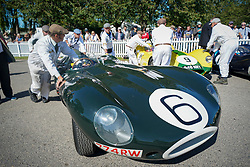 © Licensed to London News Pictures. <br /> 13/09/2019. <br /> Goodwood.West, Sussex. UK.<br /> The Goodwood Motor Circuit celebrates the 21st year of the Revival.This has become one of the biggest annual historic motorsport events in the world and the only one to be staged entirely in period dress. Each year over 150,000 people descend on this quiet corner of West Sussex to enjoy the three-day event.<br /> Pictured a classic Jaguar is pushed to the paddock.<br /> Photo credit: Ian Whittaker/LNP