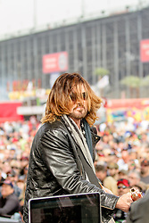 FONTANA, CA -  The multi-GRAMMY nominated, award winning, American singer-songwriter and actor BILLY RAY CYRUS performed a pre-race concert. His performance included his hit Achy Breaky Heart among standard covers such as Johnny b Goode. The Auto Club 400 is a NASCAR oficial event. 23rd march 2014. Byline, credit, TV usage, web usage or linkback must read SILVEXPHOTO.COM. Failure to byline correctly will incur double the agreed fee. Tel: +1 714 504 6870.