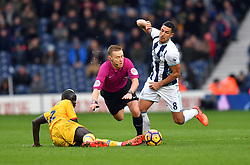 File photo dated 04-03-2017 of Referee Mike Jones is sent flying having been caught between West Bromwich Albion's Jake Livermore (right) and Crystal Palace's Mamadou Sakho (left)