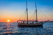 Two masted ship returning to Zadar, Croatia at sunset. Zadar is the 5th largest city in Croatia situated on the Adriatic Sea. It is the centre of Zadar County and the wider northern Dalmatian region. In the last official census of 2011 the population of Zadar was 75,082. Zadar is a historical centre of Dalmatia as well as the seat of the Roman Catholic Archdiocese of Zadar. Zadar is a city with rich history dating from prehistoric times to present days.