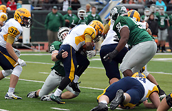 18 October 2014:  Jamar Gary gets his arms around Brandon Price during an NCAA division 3 football game between the Augustana Vikings and the Illinois Wesleyan Titans in Tucci Stadium on Wilder Field, Bloomington IL