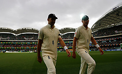 England's James Anderson and Stuart Broad leave the field due to rain during day one of the Ashes Test match at the Adelaide Oval, Adelaide.