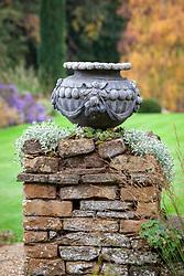 Empty urn on stone pillar at Pettifers