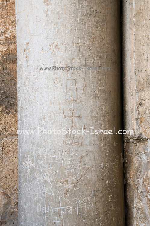 Israel, Jerusalem, Old City, Church of the Holy Sepulchre. Pilgrims engraved their mark at the entrance to the church