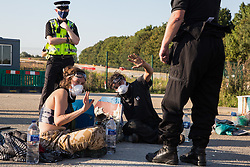Environmental activists from HS2 Rebellion use a lock-on arm tube to block a gate to the South Portal site for the HS2 high-speed rail link on 14 September 2020 in West Hyde, United Kingdom. Anti-HS2 activists blocked two gates to the same works site for the controversial £106bn rail line, one remaining closed for over six hours and another for over nineteen hours.