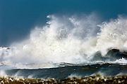 Rough waves crashing on the rocks on the Norfolk coast, UK