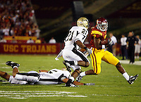 1 September 2007: Idaho #5 Brandon Olgletree and Chris Smith attempt to take down Tailback #2 C.J. Gable in action during the USC Trojans college football team defeated the Idaho Vandals 38-10 at the Los Angeles Memorial Coliseum in CA.  NCAA Pac-10 #1 ranked team first game of the season.