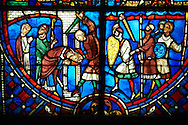 Stained glass windows depicting scenes from the life of Saint Nicaise, made in the first quarter of the 13th century from a chapel in the Cathedral of Soissons, France. The stained glass depicts the martyrdom of Saint Nicaise.  Inv OA 6006,  The Louvre Museum, Paris.